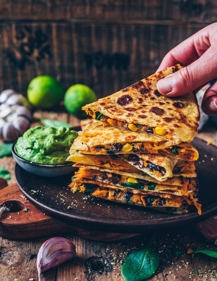 Sweet potato quesadillas with black beans, corn, cheese and guacamole