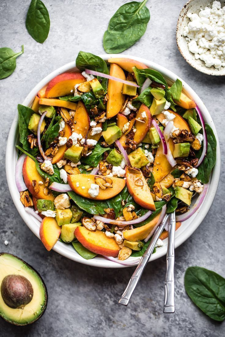 The perfect summer salad: fresh peach spinach salad with avocado, goat cheese an…