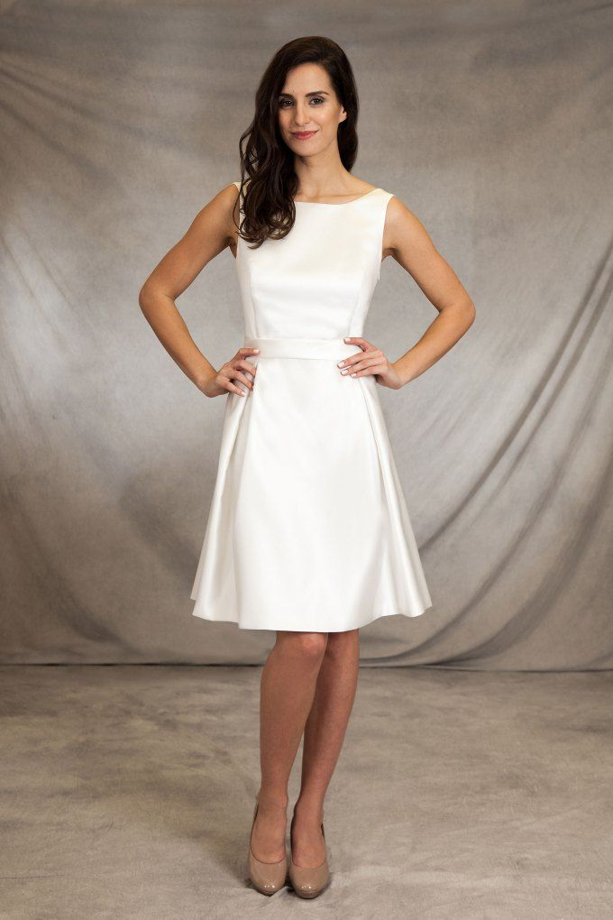 Short satin wedding dress with delicate pleats in the skirt and cut-out neckline with …