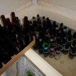 How to clean and sanitize beer bottles for home brewing using what you (probably...
