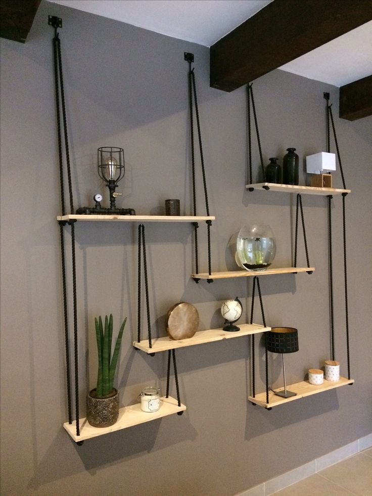 Natural wood shelves with rope and hook