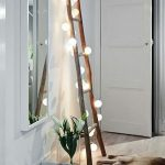 Scandinavian interior in the living room Wooden ladder with fairy lights