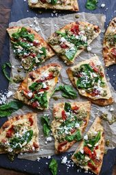 Hummus flatbread with dried tomatoes, spinach and pesto is a light …..