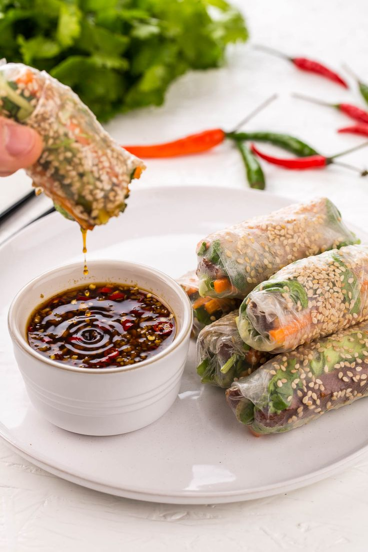 Vietnamese spring rolls with a vegetarian twist, featuring smoked tofu to make d…